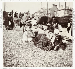 Souvenir seller on the beach  c 1905.