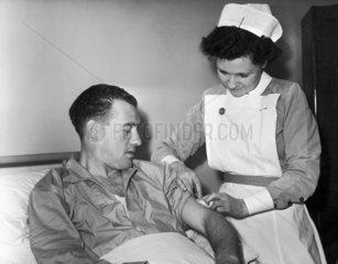 British footballer Nat Lofthouse getting an injection  November 1955.