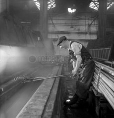 A Talbot Stead worker dipping a steel tube in an acid bath  Walsall  1948.