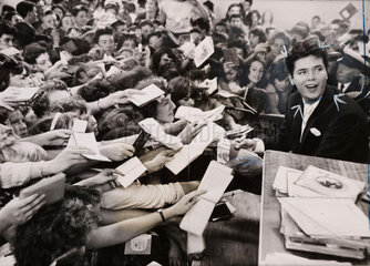 Cliff Richard mobbed by fans  London  1959.