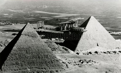HP42 G-AAUD 'Hanno' flying over the pyramids on the Cairo sector  1930s.