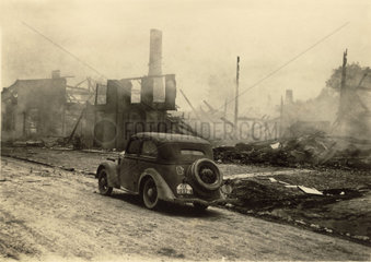 Car in a destroyed town  Second World War  1940s.