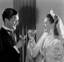 Bride and groom drinking a toast  c 1949.