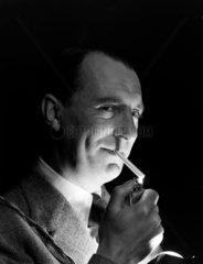 Man lighting a cigarette  1950.
