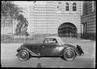 A woman in a motor car  Germany  c 1934.