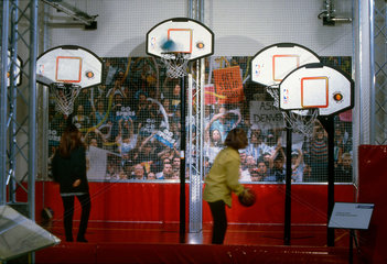 Visitors playing basketball  Science Museum  London  1997.