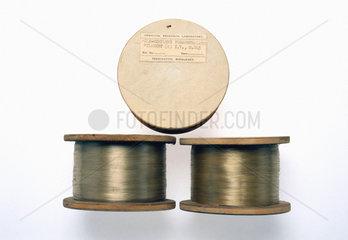 Three spools of polyethylene terephthalate filaments  1943-1944.