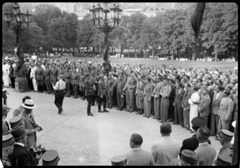 A group of men gather to give a Nazi salute  possibly Berlin  c 1931.