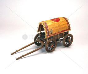 Medieval four-wheeled horse-drawn chariot.
