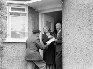 Elderly couple greet a visitor  1950.
