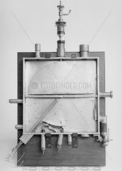 Early cyclotron designed by Lawrence and Livingston  1932.