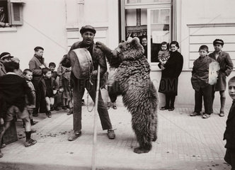 A dancing bear and its keeper on a Salonika street  Greece  1940.
