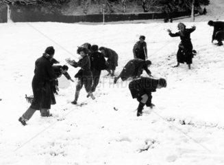 Snowball fight on Hampstead Heath in North