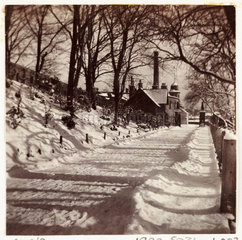 Snow-covered lane  c 1905.