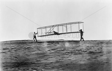 Orville Wright flying a glider at Kitty Hawk  North Carolina  USA  10 October 1902.