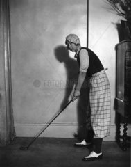 Woman modelling the latest golfing fashions  16 February 1933.