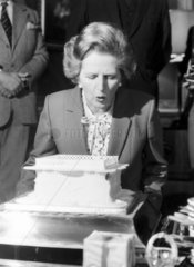Margaret Thatcher blowing out candles  c 1983.