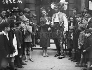 Prince Monolulu and his bride surrounded by crowds  19 August 1931.