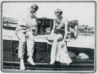 Couple listening the the radio  c 1930s.