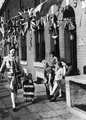 Woman and child dressed in Union Jacks  VE Day  Manchester  8 May 1945.