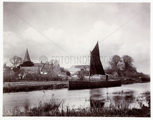 Barge on a river  c 1890.