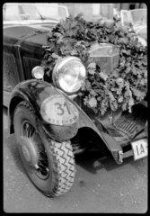 A Mercedes Benz racing car with winner's wreath  c 1934.