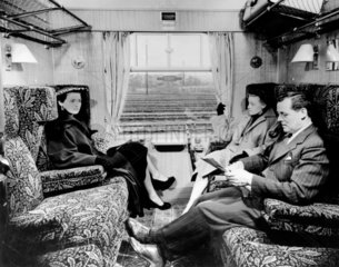 Passengers seated in British Railways FirstClass compartment  1951.
