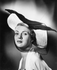 Woman wearing a wide-brimmed hat  1940s.