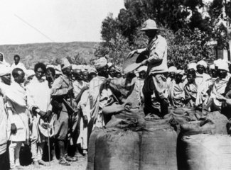 Italian troops distribute grain to Abyssinians  20 November 1935.