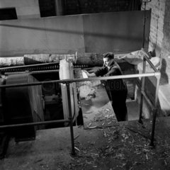 Taking the bark off logs before match production  Bryant and May  Liverpool  1955.