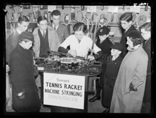 Stringing a tennis racket  Gamages  Oxford Street  London  1936.