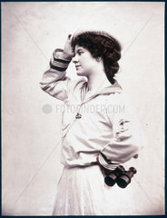 Woman posing in a sailor suit holding a pair of binoculars  c 1880-1899.
