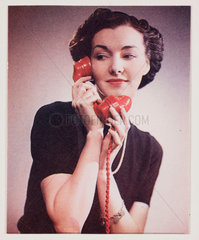 Woman on the telephone  c 1940s.