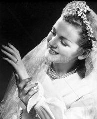 Bride admiring her wedding ring  1940s.