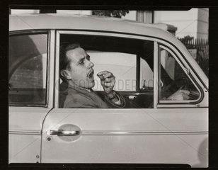Motorist taking pills  1953.
