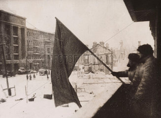 The red flag is hoisted over a recaptured part of Stalingrad  1943.
