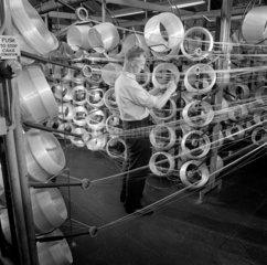 Process worker drawing fibre  fibre glass production  Birkenhead  1965.