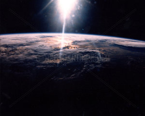 Sunlight over Earth as seen by STS-29 crew   18 March 1989.