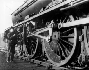Driver oiling a valve gear  1938. The drive