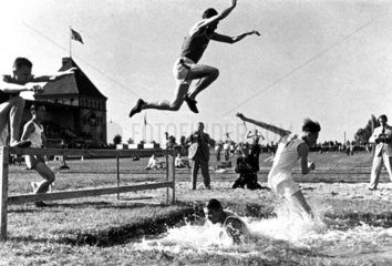 Steeplechasers negotiating the water jump