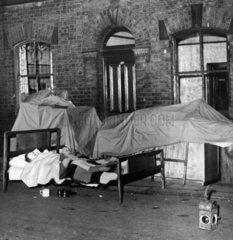 Evicted family sleeping in the street  Ashton-under-Lyne  20 June 1950.