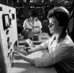 Woman making flash text of printed circuits  Hoover factory Cambuslang.