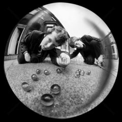 Boys playing marbles  1980.