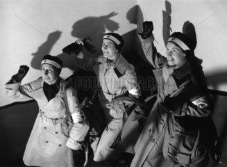 Red Cross nurses giving communist salute  January 1937.