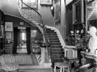 Edwardian hallway with staircase  c 1900s.