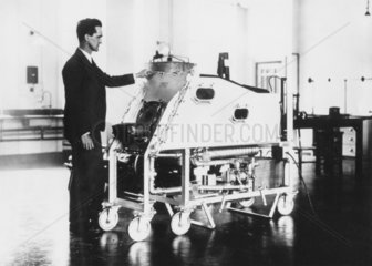 Professor Drinker with an iron lung  c 1928.