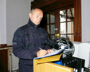 Motorcycle courier collecting a package for picture library clients  July 2001.