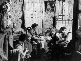 Interior of a slum  London  1 November 1934.