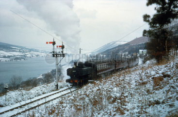 Steam train in a snowy landscape  Wales  29 December 1962.
