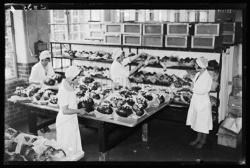 Making chocolate Easter Eggs  1933.